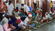 Poor people eating free food at a soup kitchen in Golden Temple, Amritsar. India Stock Footage