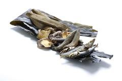 Dried food of mushroom and mackerel fish on white background Stock Photos