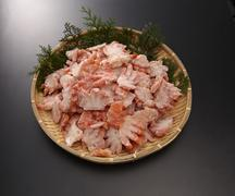Boyle red snow crab shoulder meat half-cut on bamboo tray in grey background Stock Photos