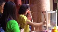 Penang, Malaysia - 7 September 2016: Asian people burning incense Stock Footage