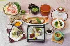 Spring Banquet Kaiseki meal with braised grouper, fresh suhi, miso soup, lemo Stock Photos