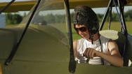 Boy sitting in old airplane Stock Footage