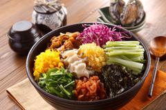 Big bowl of overture albap with squid, seaweed, cucumber, onion and ablone on Stock Photos
