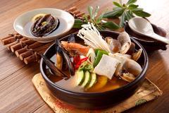 Seafood hot pot of overture jangjeongsik with blue mussel, clams, shrimp, mus Stock Photos