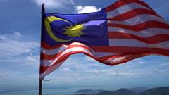 Waving Malaysian flag Stock Footage