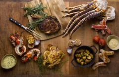 The grill mezza table meal with roasted chicken, beef, lobsters, sausages, ki Stock Photos