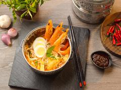Shrimp soup with laksa, egg, sprout, onion, garlic, chili sauce and noodle on Stock Photos