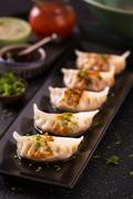 Seafood wonton in Japanese style on black platter Stock Photos