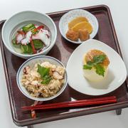 Table meal of Takikon rice in soy sauce and Sakura rice with sliced octopus a Stock Photos