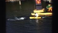 1969: dolphin pulling monkey on a surfboard YOSEMITE, CALIFORNIA Stock Footage