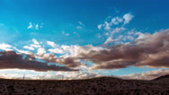 Rural mountain landscape sunset tmelapse,clouds above bare rocky hills Stock Footage
