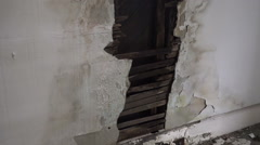 Damaged broken wall rot rotting abandoned building wall Stock Footage