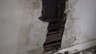Damaged broken wall rot rotting abandoned building wall Stock Footage