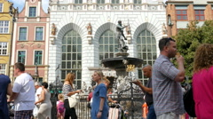 Gdansk, Poland. Old Town. Neptune fountain. Strolling tourists. Stock Footage