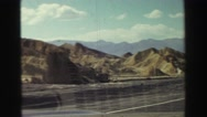 1969: a hilly area is seen with a car YOSEMITE, CALIFORNIA Stock Footage