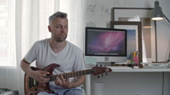 Guitar Player Practicing at Home Arkistovideo