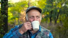 Old man drinks tea Stock Footage