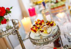 Beautifully decorated Banquet table. desserts with biscuits Stock Photos