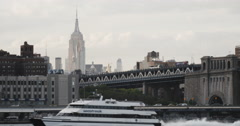 A ship passes New York City's Empire State Building Stock Footage
