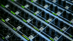 Detail with adjusting knobs on a professional audio mixer Stock Footage