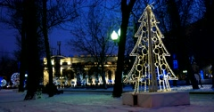 Winter and night enveloped in Chistoprudny Boulevard twinkle lights Stock Footage