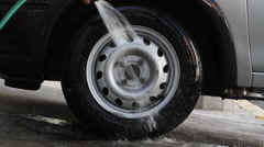Car tire washing with hose Stock Footage