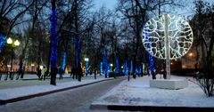 Snowy Chistoprudny Boulevard, illumination in the evening twilight, passers-by Stock Footage