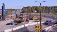 A Lot of cars go round the construction site of the temporary multi-lane road. Stock Footage