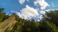 Time lapse of clouds over rock formation and trees along Columbia Gorge in OR 4k Stock Footage
