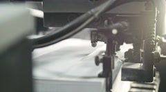 Printed sheets of paper are served in the printing press. Offset printing, CMYK Stock Footage