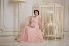 Prengant lady in vintage interior Stock Photos