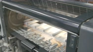 Machine working in printing house, polygraph industry - cleaning equipment Stock Footage