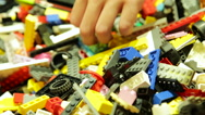 Kid look for Appropriate Lego Blocks Stock Footage