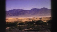 1969: a beautiful desert and rugged mountain ridgeline with a bright blue sky Stock Footage