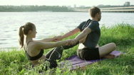 Acrobatic yoga. Stretching and massage after training. Wide angle. HD Stock Footage