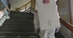 4K Astronaut returned to earth exploring an empty building Stock Footage