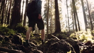 Man hiking steep terrain in slow motion. Mountain scenery, close up shot Stock Footage