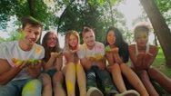 Multi-ethnic Group celebrate Holi festival in the Park , all in bright colours Stock Footage