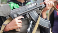 The Teenager in a Flak Jacket with a Machine Gun in his Hand Stock Footage