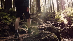 Man hiking steep terrain in slow motion. Mountain scenery Stock Footage