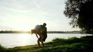 Acrobatic yoga. Young man and woman practicing acrobatic yoga. Wide angle. HD Stock Footage