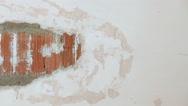 Detail of repairing damaged wall Stock Footage