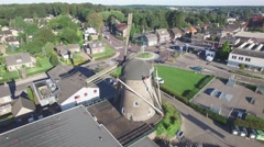 Aerial circling windmill in small town,Groesbeek,Netherlands Stock Footage