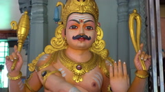 Male statue at Hindu temple, Penang, Malaysia Stock Footage
