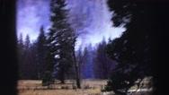 1969: a cloudy blue sky over a beautiful, rugged, smoky mountain  Stock Footage