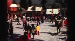 1969: hundreds of people in colorful clothing are gathered at a village resort. Stock Footage