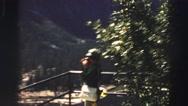 1969: the woman watching something beside the big mountain YOSEMITE, CALIFORNIA Stock Footage