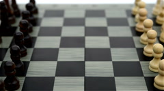 Side view white Pawn of chess moving forward Stock Footage