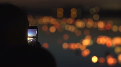 Silhouette of a woman with a phone. Festival of water lanterns Stock Footage