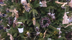 White Glitter Pail and Cones on Christmas Tree Stock Footage